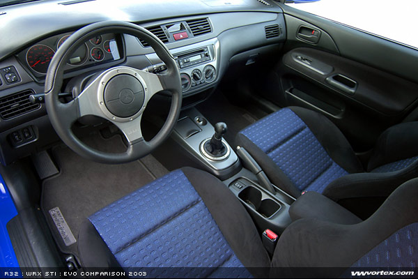 continuing on to the evos interior youll find the recaro seats are just about perfect in size and design providing a nice compromise in comfort and size